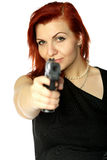 Redhead girl with pistol Stock Images