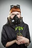 Redhead girl with plant Royalty Free Stock Images