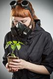 Redhead girl with plant Stock Images