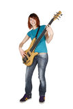 Redhead Girl Playing Bass Guitar And Smiling Royalty Free Stock Image