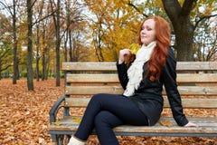 Redhead girl portrait in city park, fall season Stock Photo