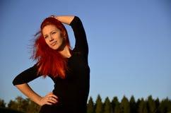 Redhead girl posing Stock Image