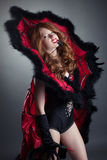 Redhead girl posing in fashionable spider costume Royalty Free Stock Photo
