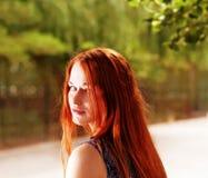 Redhead girl posing Stock Images