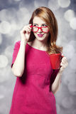 Redhead girl with red cup. Royalty Free Stock Image