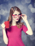 Redhead girl with red cup. Royalty Free Stock Images