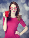 Redhead girl with red cup. Royalty Free Stock Photo