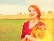 Redhead girl in red dress Stock Photography