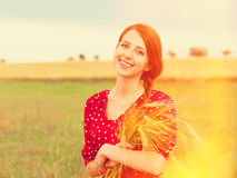 Redhead girl in red dress Stock Image