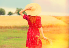 Redhead girl in red dress Stock Images