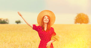 Redhead girl in red dress Royalty Free Stock Image