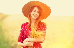 Redhead girl in red dress Royalty Free Stock Photo
