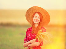 Redhead girl in red dress Royalty Free Stock Photos