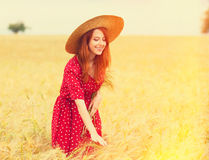 Redhead girl in red dress Stock Photo