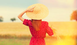 Redhead girl in red dress Royalty Free Stock Images