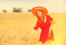 Redhead girl in red dress Royalty Free Stock Photography