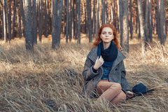 Redhead girl relaxing Royalty Free Stock Photo