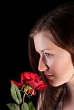 Redhead girl with rose Stock Images