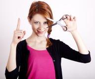 Redhead girl with scissors. Stock Photos