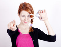 Redhead girl with scissors. Stock Images