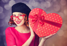 Redhead girl with shape heart box. Stock Image