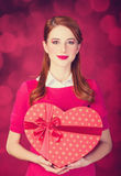 Redhead girl with shape heart box. Stock Images