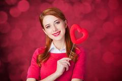 Redhead girl with shape heart toy. Stock Image