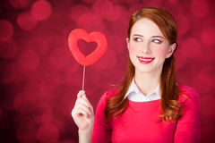 Redhead girl with shape heart toy. Royalty Free Stock Image