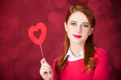 Redhead girl with shape heart toy. Stock Photo
