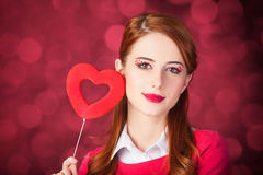 Redhead girl with shape heart toy. Stock Photography
