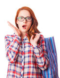 Redhead girl with shopping bag Royalty Free Stock Images