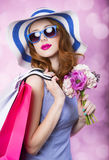 Redhead girl with shopping bags Royalty Free Stock Images