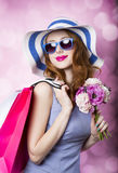 Redhead girl with shopping bags Royalty Free Stock Photography