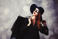 Redhead girl with shopping bags Stock Photography