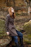 Redhead girl sitting at outdoor in autumn time royalty free stock images