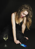 Redhead girl with smartphone and glass of wine royalty free stock image