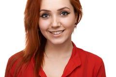 Redhead  girl smiles sweetly Stock Image