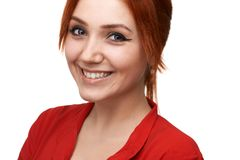 Redhead girl smiles sweetly royalty free stock photo