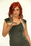 Redhead girl with snake Royalty Free Stock Images