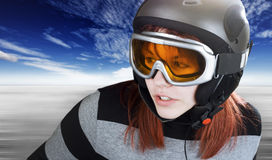 Redhead girl snowboarding. Portrait of a cute girl with red hair snowboarding on a winter background. Studio shot, composite stock photos