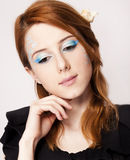 Redhead girl with style make-up. Royalty Free Stock Photography