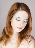 Redhead girl with style make-up. Stock Photo