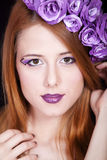 Redhead girl with style make-up and flowers Stock Photos