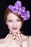 Redhead girl with style make-up and flowers Stock Photo