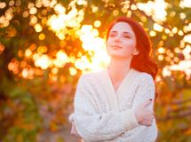Redhead girl in style white cardigan Stock Photography