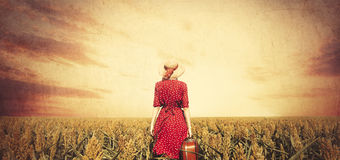 Redhead girl with suitcase. Stock Photography