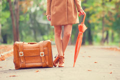 Redhead girl with suitcase Royalty Free Stock Photo