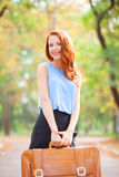 Redhead girl with suitcase Royalty Free Stock Images