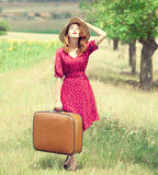 Redhead girl with suitcase at outdoor. Royalty Free Stock Photography