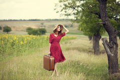 Redhead girl with suitcase at outdoor. Stock Photo